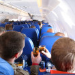 Stock Photo: Passengers in aircraft from behind