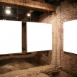 White frames on the brick wall — Stock Photo #7436624