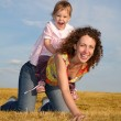 Child sits on mom — Stockfoto #7436663