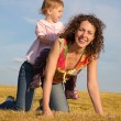 Child sits on mother — Stockfoto #7436666