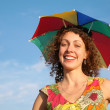 Girl in the many-colored umbrella — Stock Photo