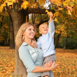 Stock Photo: Blue-eyed blond with the son in the park in autumn