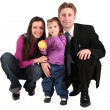 Child with apple and parents — Stock Photo