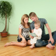 Family sit in the room on floor — Stock Photo