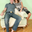 Stock Photo: Couple sit on sofa