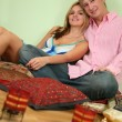 Couple sit on pillow — Stock Photo