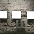 Frames on the bricks wall — Stock Photo