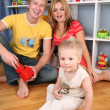 Family in playroom — Stock Photo