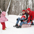 Winter family on sled — Stock Photo