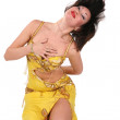 Yellow bellydancer on knees 2 — Stock Photo
