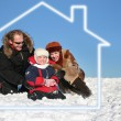 Winter family sit in dream house — Stock Photo