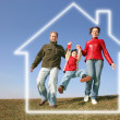 Running family in dream house — Stock Photo