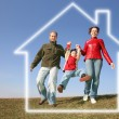 Running family in dream house — Stock Photo #7437658