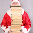 Santa Claus with a lot of books — Stock Photo