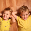 Two children lie on floor 3 — Stock Photo #7437854