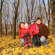 Mother and father with the children in the park in autumn — Stock Photo #7437918