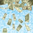 Dollars fall isolated on cloudy sky background - 图库照片