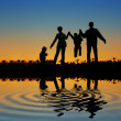 Stock Photo: Family of four sundown 2