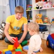 Father and child in playroom — Stock Photo