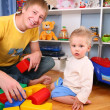 Stock Photo: Father and child in playroom 2