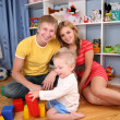 Parents and child in playroom - Foto de Stock