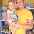 Father holds child on hands in playroom — Стоковая фотография