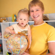 Father holds child and globe in hands — Stock Photo #7438486