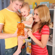 Parents hold child on hands in playroom — Stock Photo #7438487