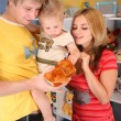 Father and mother hold son on hands in playroom - Zdjęcie stockowe