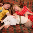 Parents with child on carpet — Stock Photo #7438505