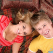 Couple lie on carpet — Stock Photo