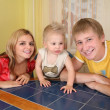 Parents with child sit at table — Stock Photo