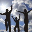 Happy family silhouette on sunny sky — Stock Photo