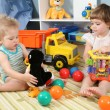 Two children in playroom with toys — Stock Photo #7438727