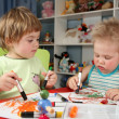 Two children painting — Stock Photo