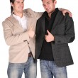 Two friends gives gesture — Stockfoto