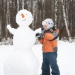 Boy makes snowman — Stock Photo #7438969