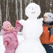Boy and girl make snowman — Stock Photo