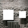Two blank frames on grey brick wall — Stock Photo #7439005