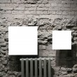 Two blank frames on grey brick wall — Stock Photo