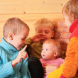 Children in the wooden room — Stock Photo