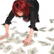 Woman gathering dollars - Stock Photo