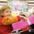 Girl with box in store — Stock Photo