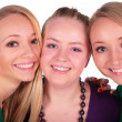 Three girls faces close-up — Stock Photo