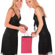 Twin girls looks in to bag 2 — Stock Photo