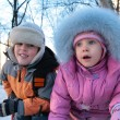 Little boy and girl on street in winter 2 — Stock Photo