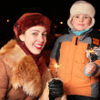 Mother and son with sparklers — Stock Photo #7439620