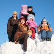 Two mothers with grand father and children on snow hill — Stock Photo