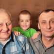 Two elderly men with boy — Stock Photo