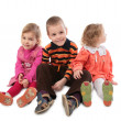 Three children sitting — Stock Photo